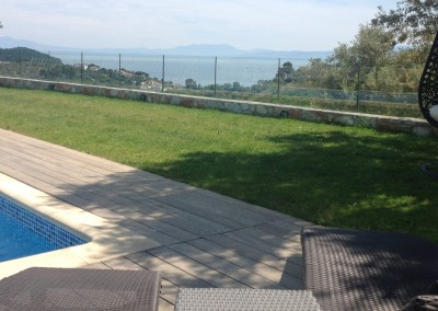 Skiathos Luxury Villas Relax on grass by pool